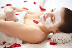 Spa Woman. Beautiful Woman Relaxes on Bed . Stock Image