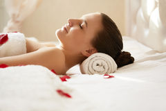 Spa Woman. Beautiful Woman Relaxes on Bed . Royalty Free Stock Photos