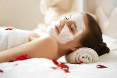 Spa Woman. Beautiful Woman Relaxes on Bed . Royalty Free Stock Photography