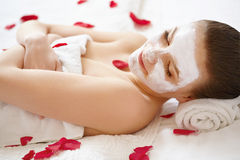Spa Woman. Beautiful Woman Relaxes on Bed . Stock Images