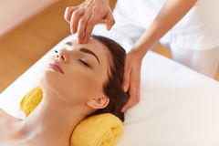 Spa Woman. Beautiful Young Woman Getting a Face Treatment at Bea Royalty Free Stock Photos