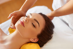 Spa Woman. Beautiful Young Woman Getting a Face Treatment at Bea Royalty Free Stock Photo