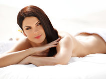 Spa Woman. Beautiful young woman relaxing after massage. Spa salon stock image