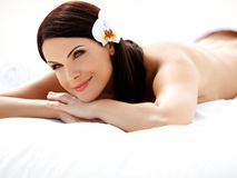 Spa Woman. Beautiful young woman relaxing after massage. Spa salon royalty free stock images