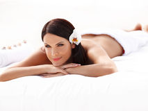 Spa Woman. Beautiful young woman relaxing after massage. Royalty Free Stock Image