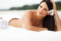Spa Woman. Beautiful young woman relaxing after massage. Spa salon stock photo