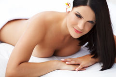 Spa Woman. Beautiful young woman relaxing after massage. Spa salon royalty free stock image