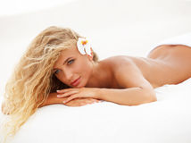 Spa Woman. Beautiful young woman relaxing after massage. Spa salon stock photos