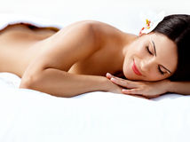 Spa Woman. Beautiful Young Woman Relaxing After Massage. Spa salon royalty free stock photography