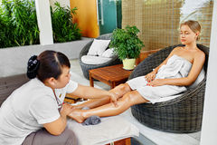 Spa Woman Body Care. Aromatherapy Leg Massage. Skincare Treatment Stock Images