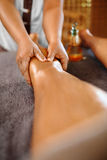 Spa Woman. Body Care. Legs Oil Massage Therapy. Skin Care. Spa Woman. Body Care. Closeup Masseur Doing Hand Massage Therapy On Female Legs With Essential Oils In stock images