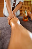 Spa Woman. Body Care. Legs Oil Massage Therapy. Skin Care stock photography
