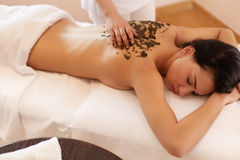 Spa Woman. Brunette Getting a Marine Algae Wrap Treatment in Spa Royalty Free Stock Photography