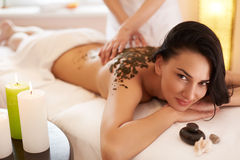 Spa Woman. Brunette Getting a Marine Algae Wrap Treatment in Spa Stock Image