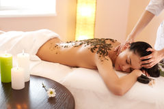 Spa Woman. Brunette Getting a Marine Algae Wrap Treatment in Spa Stock Photography