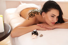 Spa Woman. Brunette Getting a Marine Algae Wrap Treatment in Spa Stock Images