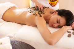 Spa Woman. Brunette Getting a Marine Algae Wrap Treatment in Spa Stock Photos