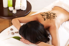 Spa Woman. Brunette Getting a Marine Algae Wrap Treatment in Spa Royalty Free Stock Photo