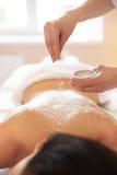 Spa Woman. Brunette Getting a Salt Scrub Beauty Treatment in the. Spa. Body Scrub Royalty Free Stock Photo