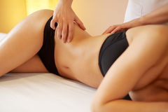 Spa Woman. Close-up of a Woman Getting Spa Treatment. Body Massa Stock Images