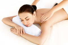 Spa Woman. Close-up of a young woman getting spa treatment. Face. Massage Royalty Free Stock Image