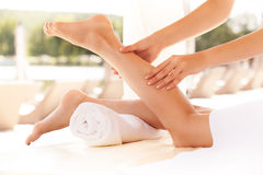 Spa Woman. Close-up of a young woman getting spa treatment. Foot. Massage Stock Photography