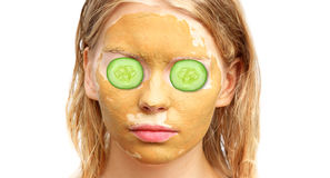Spa Woman Face with facial Clay Mask Organic Beauty treatments Royalty Free Stock Photography