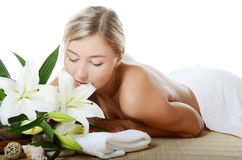 Spa Woman with flowers of a lily Stock Images