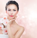 Spa woman with fresh skin. Beauty girl touching her face Stock Photo