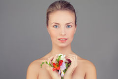 Spa Woman. Healthy Woman with Clear Skin and Flowers Royalty Free Stock Photography