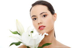 Spa woman with lily flower Royalty Free Stock Photography