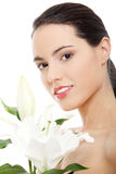 Spa woman with lily flower Royalty Free Stock Image