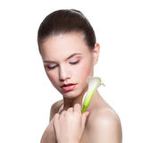 Spa Woman with Lily Flower Isolated. Healthy Skin, Cute Face Royalty Free Stock Photo