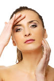 Spa woman with make up touching her face. Stock Photos