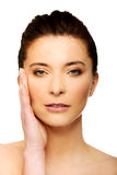 Spa woman with make up touching her face. Stock Photography