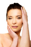 Spa woman with make up touching her face. Royalty Free Stock Image