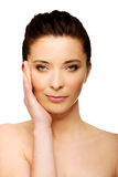 Spa woman with make up touching her face. Stock Images