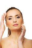 Spa woman with make up touching her face. Stock Image
