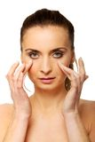 Spa woman with make up touching her face. Royalty Free Stock Photo