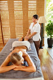 Spa Woman. Oil Leg Massage Therapy, Treatment. Body Skin Care. Spa Woman. Aromatherapy Oil Leg Massage Therapy. Masseur Massaging Young Long Female Legs In royalty free stock photography
