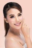 Spa Woman Portrait. Beautiful Asian Girl Touching her Face. Perfect Fresh Skin. Stock Photo