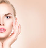 Spa woman portrait. Beautiful girl touching her face Royalty Free Stock Image