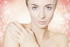 Spa woman portrait with christmas snowflakes background. Beauty spa woman portrait with christmas snowflakes background Stock Photos