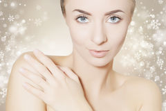 Spa woman portrait with christmas snowflakes background. Beauty spa woman portrait with christmas snowflakes background Stock Photo