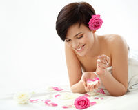 Spa Woman. Portrait of a Smiling Young Woman With Flower on a Wh Stock Photos
