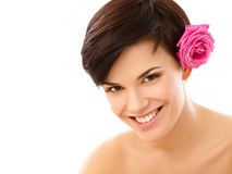 Spa Woman. Portrait of a Smiling Young Woman With Flower Royalty Free Stock Photos