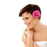 Spa Woman. Portrait of a Smiling Young Woman With Flower Royalty Free Stock Photo