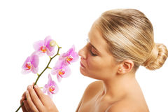 Spa woman with purple orchid Stock Images