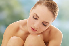 Spa woman sitting on the floor. Royalty Free Stock Photos