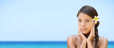 Spa woman on travel beach resort - panorama banner. Spa woman on travel beach resort with perfect skin for beauty skin care. Beautiful mixed race Caucasian Asian Royalty Free Stock Images